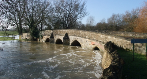 A_swollen_River_Welland_passing_beneath_the_old_bridge_in_Duddington_-_geograph.org.uk_-_1723195